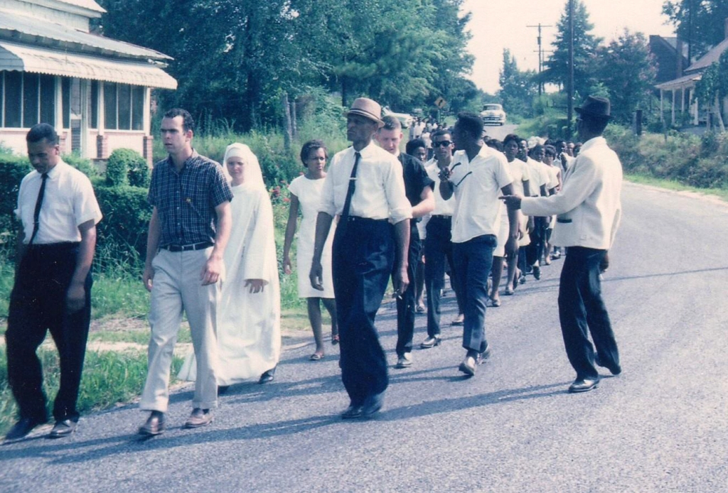 Marching to the courthouse, Crawfordsville GA. 1965. Photo Credit: https://www.crmvet.org/images/imgscope.htm